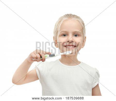Cute little girl brushing teeth on white background