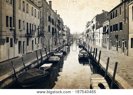 Narrow Canal And Embankment In Venice, Italy