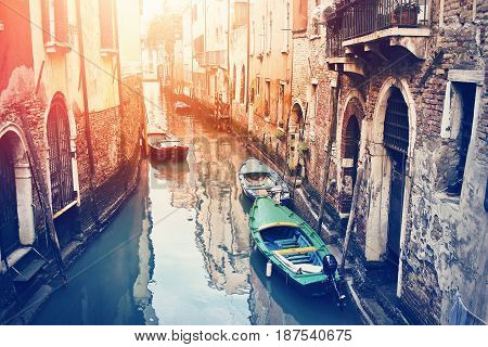 Winding Old Canal In Venice, Italy