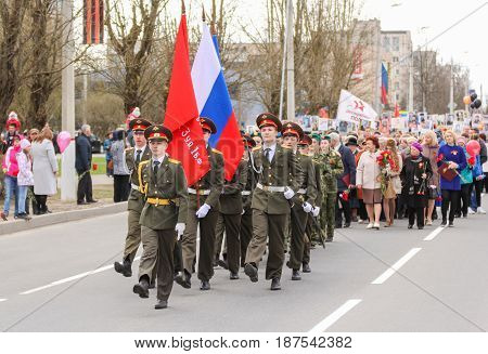 Kirishi, Russia - 9 May, The standard group at the head of the column, 9 May, 2017. Preparation and conduct of the action Immortal regiment in small cities of Russia.