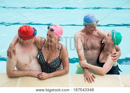 High angle view of senior couples enjoying in pool