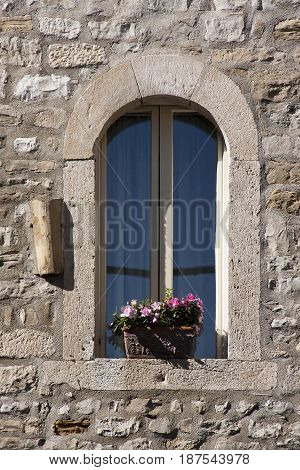 Rounded window on the wall inside of Diocletian palace