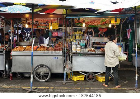 BANGKOK THAILAND- MAY 19 2017: Vendor sells street food to customers at Chatuchak weekend market. It is one of the largest market in Asia.