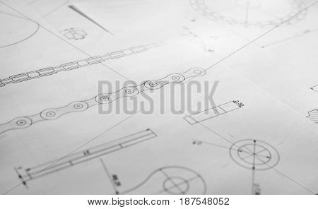 Part blueprints as background. Engineering concept