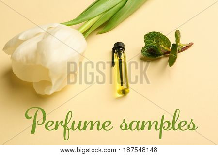 Perfume sample with tulip and mint on color background