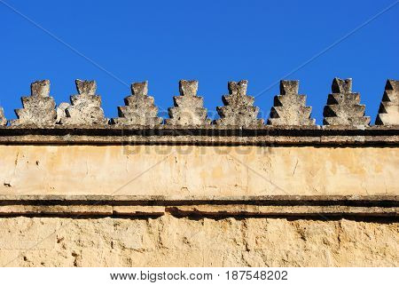 Geometric figured ornaments on an old wall