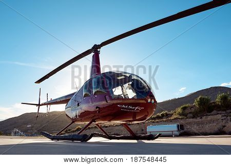 Benidorm Spain - May 13 2017: Helicopter on a landing field. Benidorm helicopter tour is a tourist attraction on the Costa Blanca. Province of Alicante. Spain