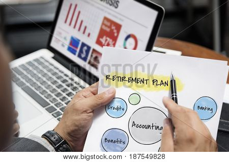 Business person working on a project with notepad and laptop