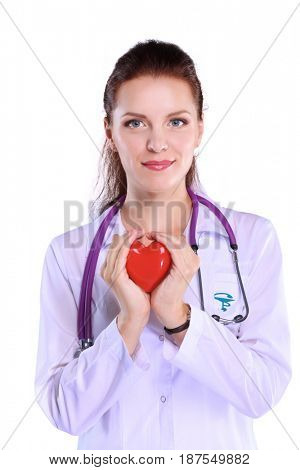 Positive female doctor standing with stethoscope and red heart symbol