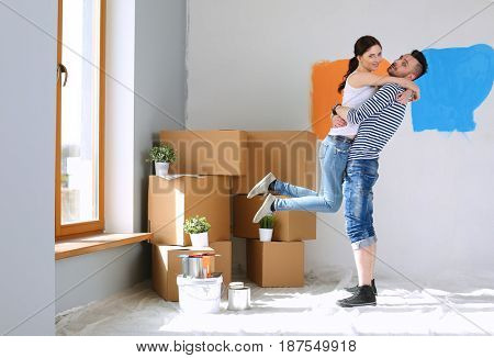 Happy young couple moving in new house