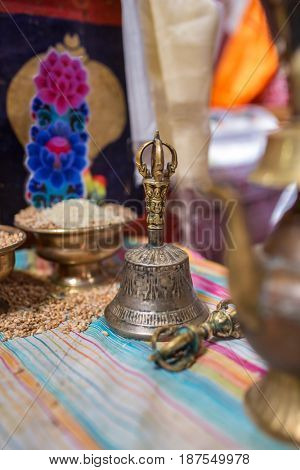 Traditional ceremonial bell and vajra in Buddhist temple in Nepal. Tibetan Buddhism detail