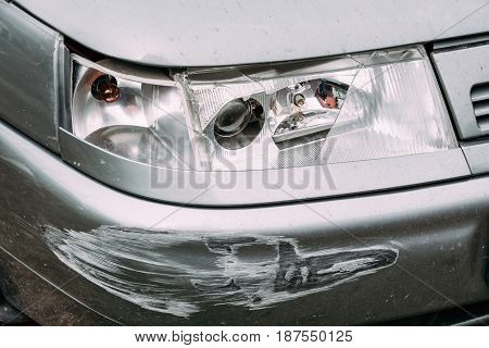 Broken Lamp Headlight And Bumper Car Scratched With Deep Damage To Paint.