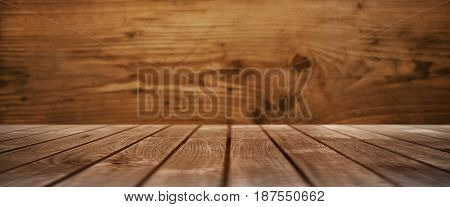 Wooden table in front of a wall from wood for a rustic still life
