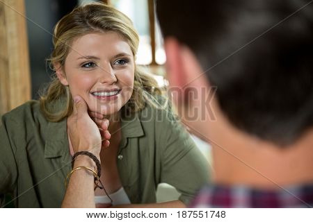 Romantic young man touching womans face in coffee shop