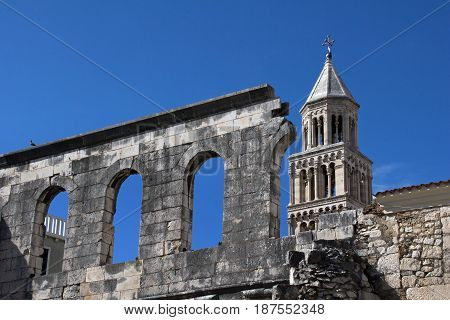 The wall above silver gate and bell tower of cathedral of St Domnius