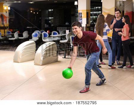 Friends having fun at bowling club