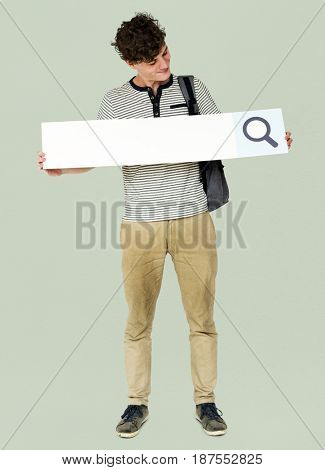 Young adult man holding blank searching banner