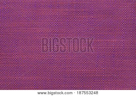Pink and purple background with chess pattern closeup. Structure of magenta fabric with checkerboard pattern macro.