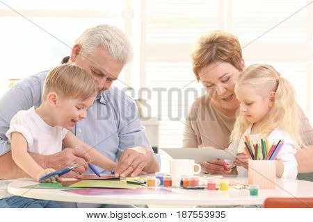 Grandparents and grandchildren spending time together at home