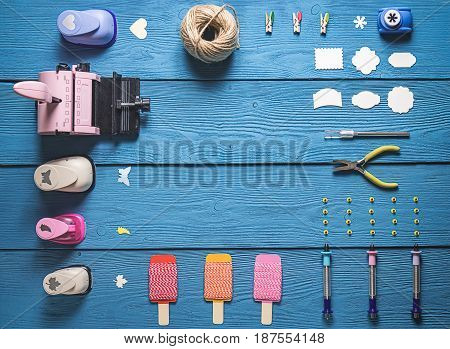 Top View Of The Layout Of Tools For Needlework And Scrapbooking On Wooden Boards