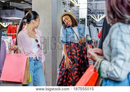 Multicultural Hipster Girls Choosing Clothes In Boutique, Fashion Shopping Girls Concept