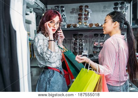 multicultural hipster girls in boutique friends shopping concept concept