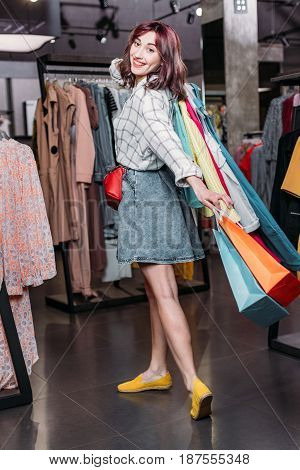 Young Hipster Girl With Shopping Bags In Boutique, Clothes Shopping Concept