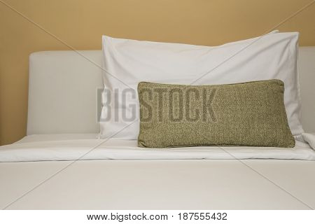 Pillows on bed decoration in bedroom interior