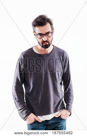 Portrait of a young bearded man with glasses