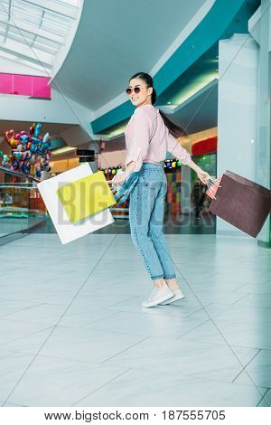 Happy Young Woman In Sunglasses Walking With Shopping Bags, Boutique Shopping Concept