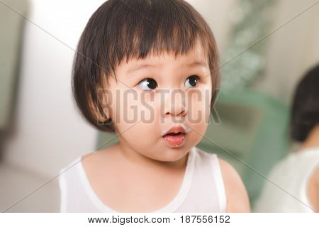 Cute Baby Girl With Milk Mustache At Home