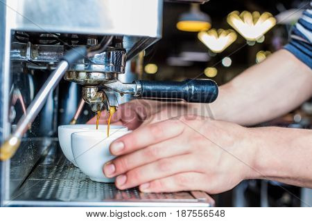 Side View Of Barista Preparing Fresh Coffee In Cafe