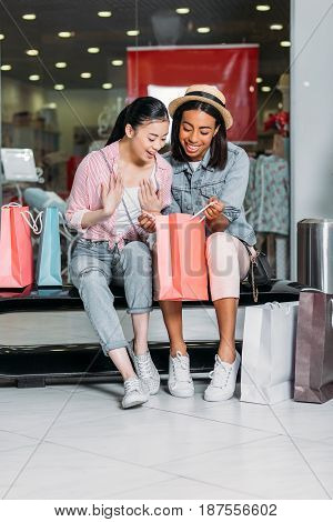 Stylish Women Friends Shopping Together At Shopping Mall