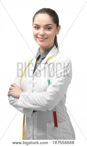 Portrait of young female nutritionist on white background