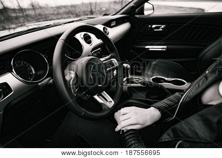 Car interior with female driver