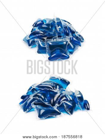 Pile of multiple washing pod capsules isolated over the white background, set of two different foreshortenings