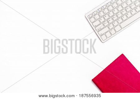 Pink Diary And Keyboard On A White Background. Minimal Feminine Business Concept.