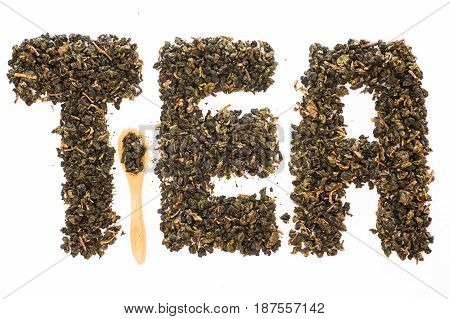 Alphabet word TEA from tea leaves isolated on white background