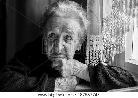 Black-and-white portrait of an elderly woman.