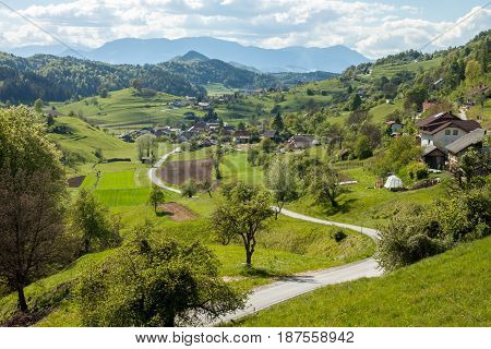 mountain cute village in Slovenia between green hills
