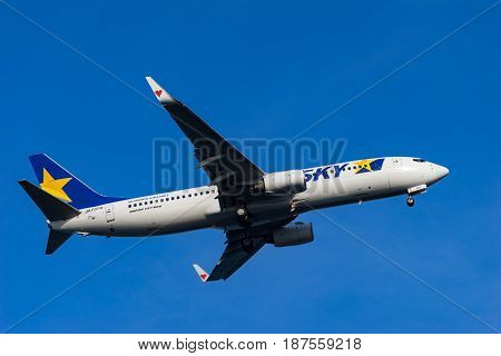 TOKYO, JAPAN - MAY 21, 2017: Boeing 737-800 landing to the Haneda International Airport in Tokyo, Japan.