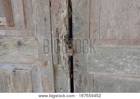 master key lock on old wooden and decay door house