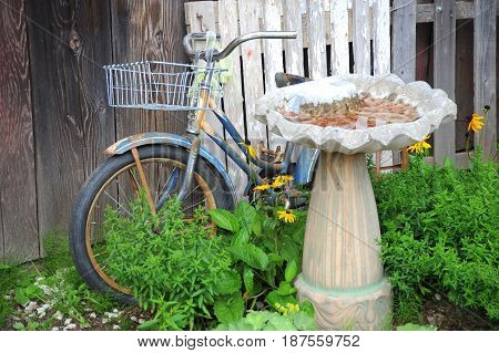 Vintage bike with basket against a wall outside.