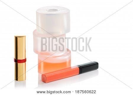 Perfume bottle and cosmetics for ladies on a white background