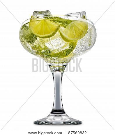 fresh fruit alcohol cocktail or mocktail in margarita glass with ice cubes, lime and mint isolated on white background