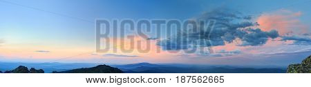 Sunset Over The Mountainous Terrain. The Nature Of The Southern Urals. Sunset Sky Over The Forest An