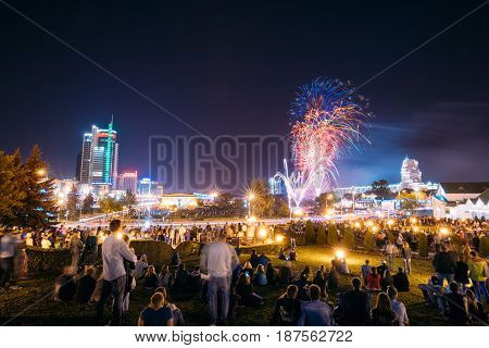 Minsk, Belarus - September 3, 2016: Festive Salute During Celebration Of The Day Of Minsk City. Business Center Royal Plaza, House Near Trinity Suburb At Summer Evening, Night Lights Illumination