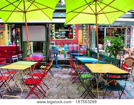 PARIS, FRANCE-JULY 28, 2016: Picturesque colorful cafe terrace close to the Pantheon-Sorbonne University