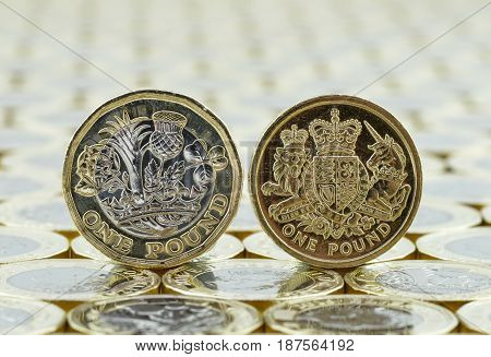 Comparison Of Old And New British One Pound Coins.