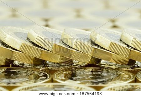 Macro Fallen Stack Of New British One Pound Coins